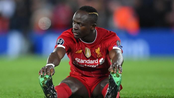 LIVERPOOL, ENGLAND - MARCH 11: Sadio Mane of Liverpool looks dejected during the UEFA Champions League round of 16 second leg match between Liverpool FC and Atletico Madrid at Anfield on March 11, 2020 in Liverpool, United Kingdom.  (Photo by Laurence Griffiths/Getty Images)