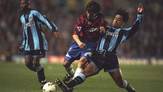 9 Apr 1997:  Richard Shaw (right) of Coventry tackles Gianfranco Zola of Chelsea during the Premier League match at Highfield Road in Coventry, England. Coventry won 3-1.  Mandatory Credit: Allsport UK /Allsport