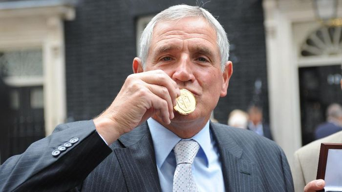 LONDON, UNITED KINGDOM - JUNE 10: Norman Hunter kisses his medal, presented by Prime Minister Gordon Brown for representing his country in the 1966 World Cup  on June 10, 2009 in London England. When England lifted the World Cup it was customary that only the 11 players on the pitch at the final whistle were awarded medals. Today, Prime Minister Gordon Brown handed out medals to the other players and families of the backroom staff. (Photo by Ian Nicholson/WPA Pool/Getty Images)