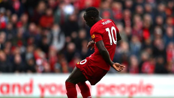 LIVERPOOL, ENGLAND - MARCH 07: Sadio Mane of Liverpool scores his teams second goal during the Premier League match between Liverpool FC and AFC Bournemouth  at Anfield on March 07, 2020 in Liverpool, United Kingdom. (Photo by Jan Kruger/Getty Images)