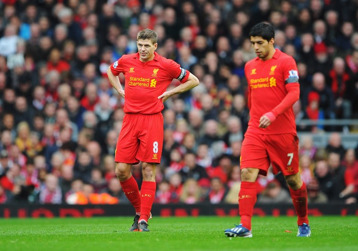 LIVERPOOL, ENGLAND - APRIL 21: Steven Gerrard (L) of Liverpool and team mate Luis Suarez look dejected after the opening goal by Oscar of Chelsea during the Barclays Premier League match between Liverpool and Chelsea at Anfield on April 21, 2013 in Liverpool, England.  (Photo by Michael Regan/Getty Images)