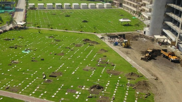 Aerial view of new graves at the Jardines de la Esperanza cemetery in Guayaquil, Ecuador, on April 12, 2020, as the number of deaths increased due to COVID-19 infections. (Photo by Jose Snchez / AFP)