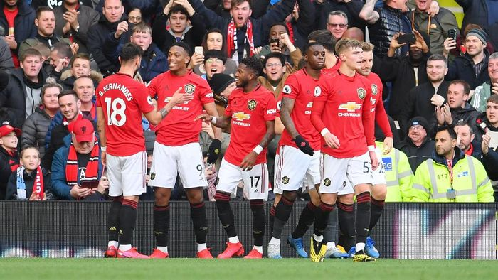 MANCHESTER, ENGLAND - MARCH 08: Anthony Martial of Manchester United celebrates with his team after scoring his sides first goal during the Premier League match between Manchester United and Manchester City at Old Trafford on March 08, 2020 in Manchester, United Kingdom. (Photo by Laurence Griffiths/Getty Images)