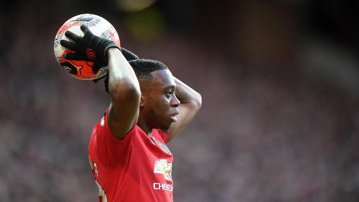 MANCHESTER, ENGLAND - MARCH 08: Aaron Wan-Bissaka of Manchester United throws the ball in during the Premier League match between Manchester United and Manchester City at Old Trafford on March 08, 2020 in Manchester, United Kingdom. (Photo by Michael Regan/Getty Images)