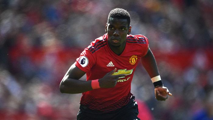 Manchester United v Cardiff City - Premier League MANCHESTER, ENGLAND - MAY 12: United player Paul Pogba in action during the Premier League match between Manchester United and Cardiff City at Old Trafford on May 12, 2019 in Manchester, United Kingdom. (Photo by Stu Forster/Getty Images)