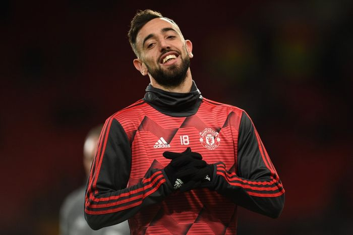 Manchester Uniteds Portuguese midfielder Bruno Fernandes warms up prior to the UEFA Europa League round of 32 second leg football match between Manchester United and Club Brugge at Old Trafford in Manchester, north west England, on February 27, 2020. (Photo by Oli SCARFF / AFP)