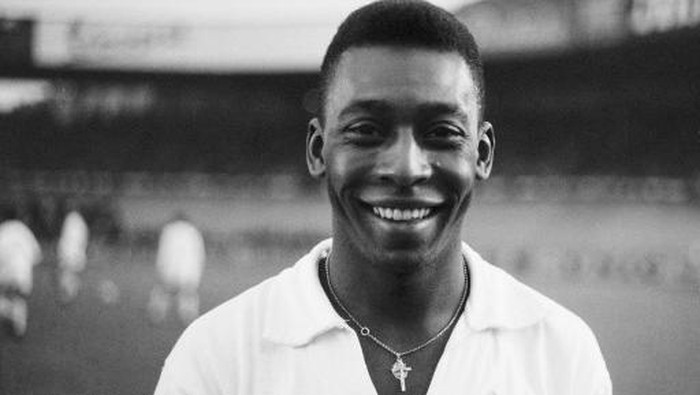 Brazilian striker Pel, wearing his Santos jersey, smiles before playing a friendly soccer match with his club against the French club of