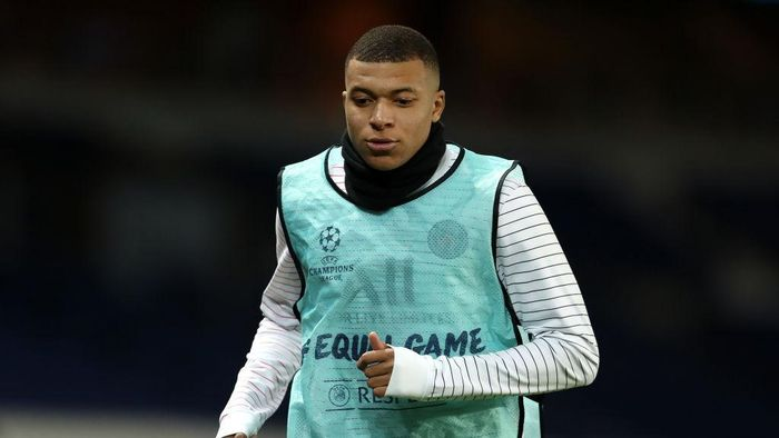 PARIS, FRANCE - MARCH 11: (FREE FOR EDITORIAL USE) In this handout image provided by UEFA, Kylian Mbappe of Paris Saint-Germain warms up during the UEFA Champions League round of 16 second leg match between Paris Saint-Germain and Borussia Dortmund at Parc des Princes on March 11, 2020 in Paris, France. The match is played behind closed doors as a precaution against the spread of COVID-19 (Coronavirus).  (Photo by UEFA - Handout/UEFA via Getty Images)