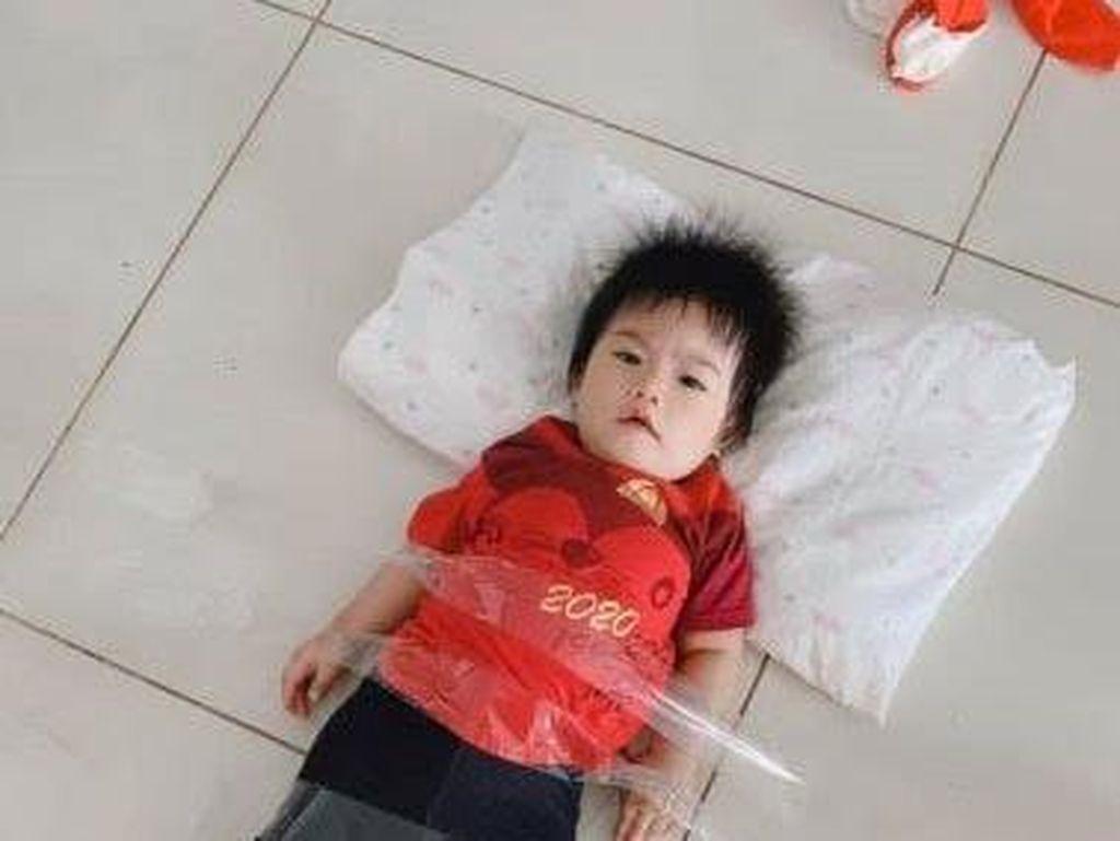 Viral Foto Balita Dipasung Pakai Selotip agar Ayah Bisa Kerja dari Rumah