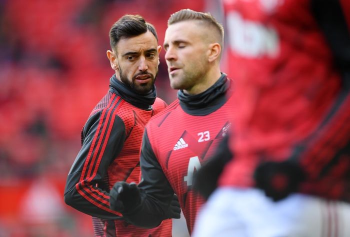 MANCHESTER, ENGLAND - MARCH 08: Bruno Fernandes of Manchester United warms up with Luke Shaw of Manchester United ahead of the Premier League match between Manchester United and Manchester City at Old Trafford on March 08, 2020 in Manchester, United Kingdom. (Photo by Laurence Griffiths/Getty Images)