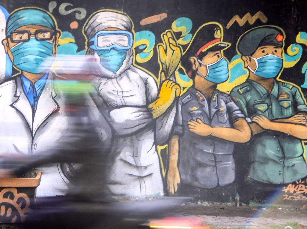 Aksi Peringatan Wabah COVID-19 Melalui Mural