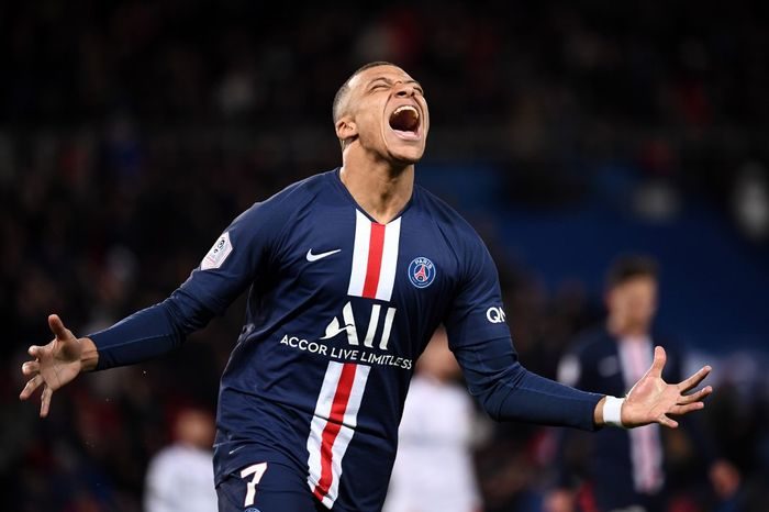 Paris Saint-Germains French forward Kylian Mbappe celebrates after scoring a goal during the French L1 football match between Paris Saint-Germain (PSG) and Dijon, on February 29, 2020 at the Parc des Princes stadium in Paris. (Photo by FRANCK FIFE / AFP)