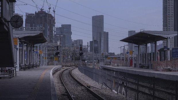 In this Monday, April 6, 2020 photo, a railway station is deserted after authorities shut down railway service in effort to contain the spread of the coronavirus, in Tel Aviv, Israel. The once thrumming city of Tel Aviv, famed for its nightlife and bustling beachfront, has fallen eerily quiet due to Israel's tight movement restrictions to halt the spread of the coronavirus. (AP Photo/Oded Balilty)