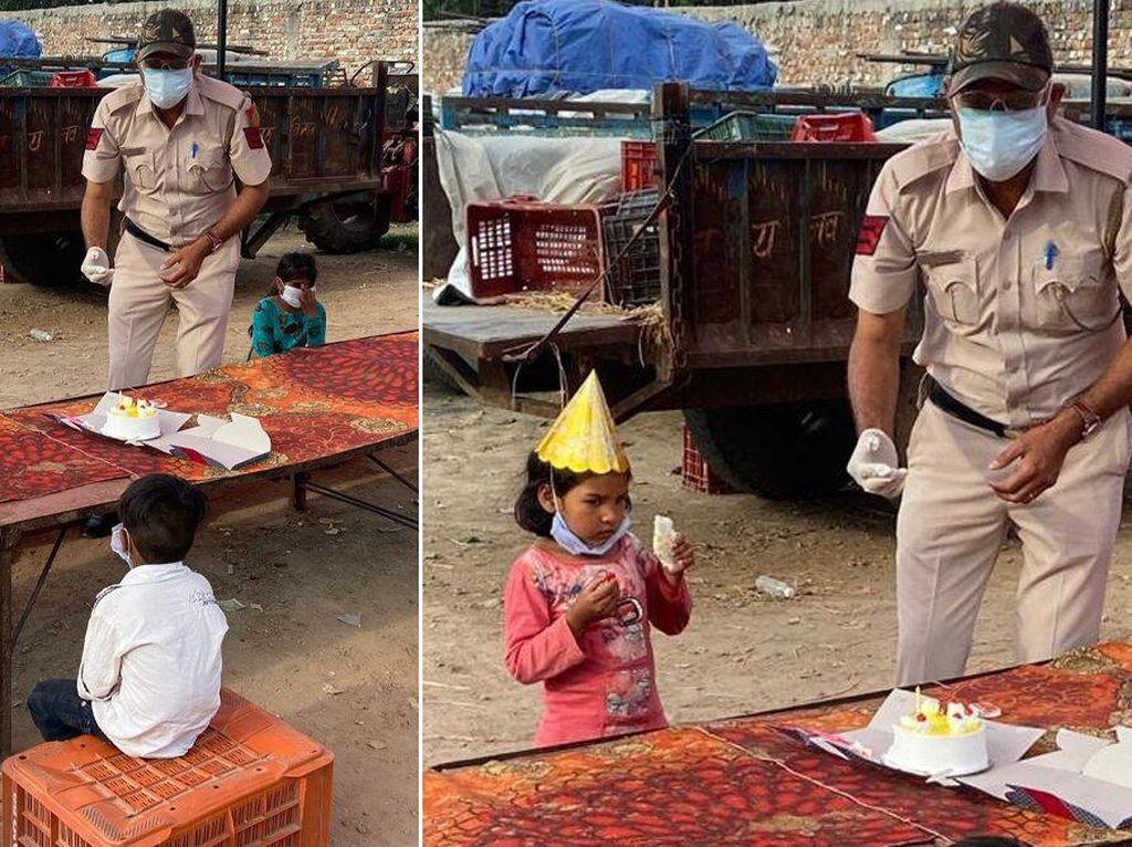 Polisi Ini Bawa Kue dan Rayakan Ulang Tahun Putri Seorang Buruh