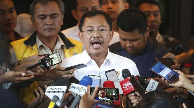 In this Feb. 15, 2020, photo, Indonesian Health Minister Terawan Agus Putranto, center, talks to the media at Halim Perdanakusuma Airport in Jakarta, Indonesia. While its neighbors scrambled early this year to try to contain the spread of the new coronavirus, the government of the world's fourth most populous nation insisted that everything was fine. Only after the first cases were confirmed in March did President Joko Widodo acknowledge that his government was deliberately holding back information about the spread of the virus to prevent the public from panicking. The country now has the the highest death toll in Asia after China. (AP Photo/Achmad Ibrahim)