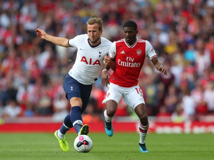LONDON, ENGLAND - SEPTEMBER 01: Harry Kane of Tottenham Hotspur and Ainsley Maitland Niles of Arsenal in action during the Premier League match between Arsenal FC and Tottenham Hotspur at Emirates Stadium on September 01, 2019 in London, United Kingdom. (Photo by Catherine Ivill/Getty Images)