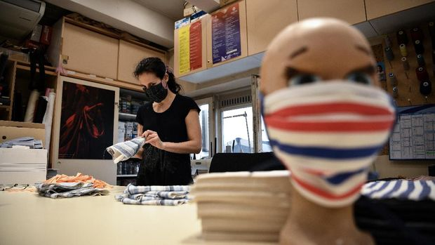 A picture shows face masks made out of fabric by seamstresses from the Opera de Marseille in the sewing workshop of the Marseille opera house on April 20, 2020, in Marseille, southeastern France, as the country is under lockdown to stop the spread of the COVID-19 pandemic, caused by the novel coronavirus. - Usually accustomed to making production costumes,  dressmakers and seamstresses in opera houses across France, including Marseille, Bordeaux and Paris, have converted their trade to manufacturing face masks amid the coronavirus crisis. (Photo by Anne-Christine POUJOULAT / AFP)