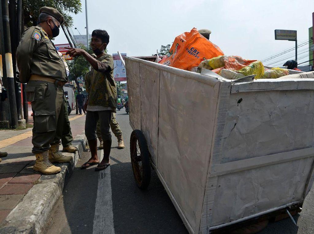 14 Wewenang Satpol PP DKI sebagai Penyidik di Draf Perda Corona