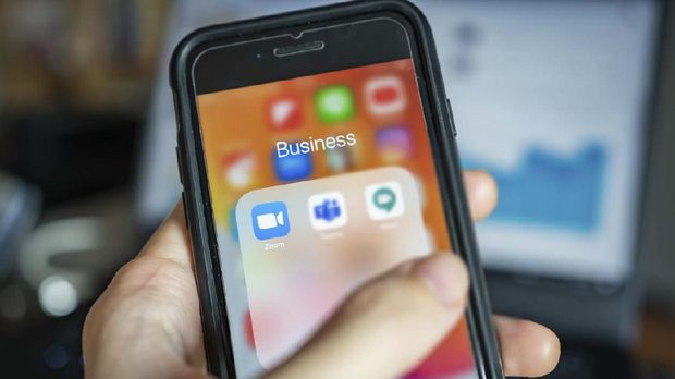 Bangkok, Thailand - April 1, 2020 : iPhone 7 showing its screen with popular online meeting applications which are Zoom, Microsoft Teams and Hangouts Meet by Google.