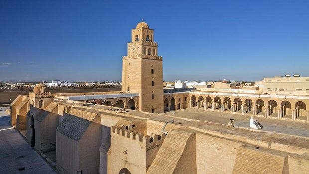 Tunisia - Kairouan - The panoramic view of fortress-like Great Mosque aka the Mosque of Sidi-Uqba and its minaret (built 9th century) are listed as UNESCO World Heritage and is one of the most impressive and largest Islamic monuments in North Africa