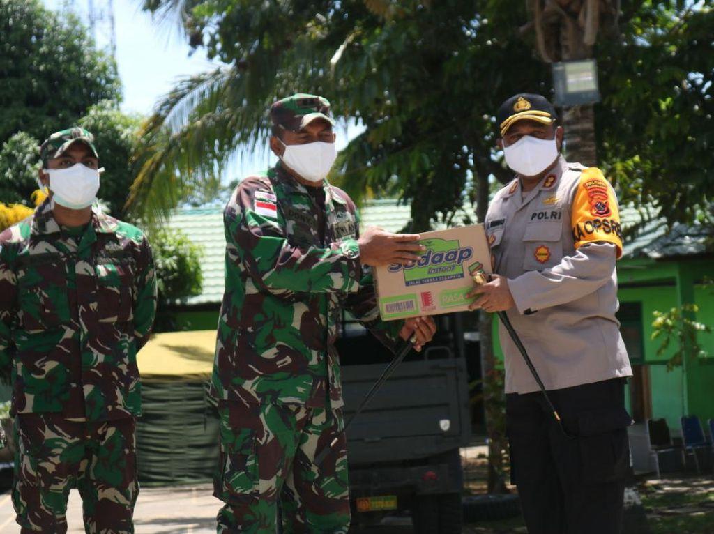 Kapolresta Jayapura Salurkan Bantuan ke Personel Satgas Pamtas RI-PNG