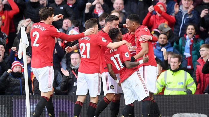MANCHESTER, ENGLAND - MARCH 08: Anthony Martial of Manchester United celebrates with his team after scoring his sides first goal during the Premier League match between Manchester United and Manchester City at Old Trafford on March 08, 2020 in Manchester, United Kingdom. (Photo by Michael Regan/Getty Images)