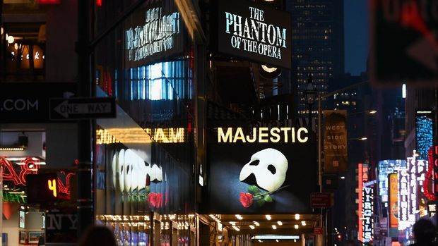 (FILES) In this file photo taken on March 12, 2020 signage of the Broadway play