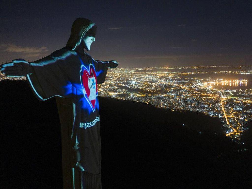 Kini, Patung Yesus di Brasil Bermandikan Cahaya dan Bermasker