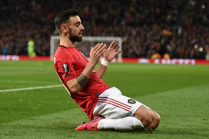 Manchester Uniteds Portuguese midfielder Bruno Fernandes celebrates scoring his teams first goal during the UEFA Europa League round of 32 second leg football match between Manchester United and Club Brugge at Old Trafford in Manchester, north west England, on February 27, 2020. (Photo by Oli SCARFF / AFP)