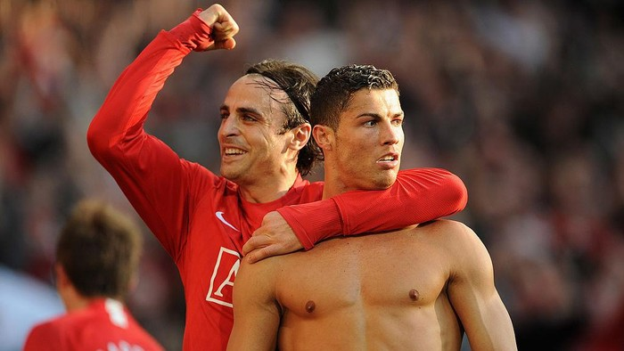 MANCHESTER, ENGLAND - APRIL 25:  Cristiano Ronaldo (R) of Manchester United is congratulated by team mate Dimitar Berbatov after scoring his teams third goal during the Barclays Premier League match between Manchester United and Tottenham Hotspur at Old Trafford on April 25, 2009 in Manchester, England.  (Photo by Shaun Botterill/Getty Images)