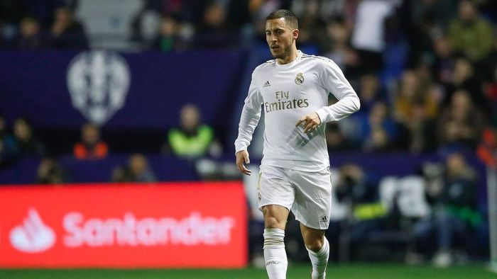 VALENCIA, SPAIN - FEBRUARY 22: Eden Hazard of Real Madrid runs with the ball during the Liga match between Levante UD and Real Madrid CF at Ciutat de Valencia on February 22, 2020 in Valencia, Spain. (Photo by Eric Alonso/Getty Images)