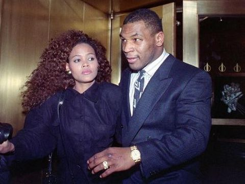 US heavyweight champion Mike Tyson exits the Nippon Television Network International studio in New York with his new bride actress Robin Givens, 09 February 1988. Tyson attended the live satellite press conference between New York and Japan from the studio to promote his, 21 March 1988, title bout with Tony Tubbs to be held in Japan's Tokyo Dome. (Photo by MARIA BASTONE / AFP)