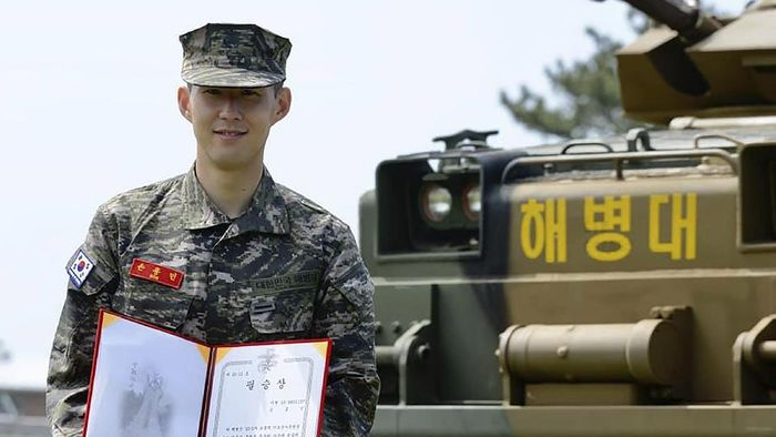 In this photo provided by South Korea Marine Corps Facebook, Tottenham Hotspur forward Son Heung-min poses with a prize during a basic military training completion ceremony at a Marine Corps boot camp in Seogwipo on Jeju Island, South Korea, Friday, May 8, 2020. Son finished his three-week military training in South Korea on Friday and was right near the top of the class.(South Korea Marine Corps Facebook via AP)