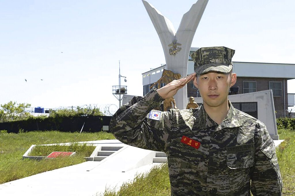 In this undated photo provided by South Korea Marine Corps' Facebook on Friday, May 8, 2020, Tottenham Hotspur forward Son Heung-min salutes at a Marine Corps boot camp in Seogwipo on Jeju Island, South Korea. Son finished his three-week military training in South Korea on Friday and was right near the top of the class.(South Korea Marine Corps' Facebook via AP).