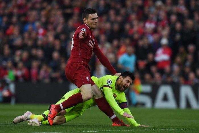 Barcelonas Argentinian striker Lionel Messi (R) is tackled by Liverpools Scottish defender Andrew Robertson during the UEFA Champions league semi-final second leg football match between Liverpool and Barcelona at Anfield in Liverpool, north west England on May 7, 2019. (Photo by Paul ELLIS / AFP)