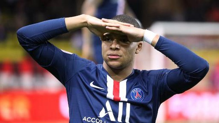 (FILES) In this file photo taken on January 15, 2020 Paris Saint-Germains French forward Kylian Mbappe reacts during  the French L1 football match between Monaco (ASM) and Paris Saint-Germain (PSG) at the Louis II Stadium in Monaco on January 15, 2020. - The football season in France has been declared over following a league vote on Thursday, with Paris Saint-Germain being named as champions. PSG topped the Ligue 1 table by 12 points from Marseille when the season was suspended in mid-March because of the coronavirus outbreak, which has gone on to kill more than 24,000 people in France. (Photo by Valery HACHE / AFP)