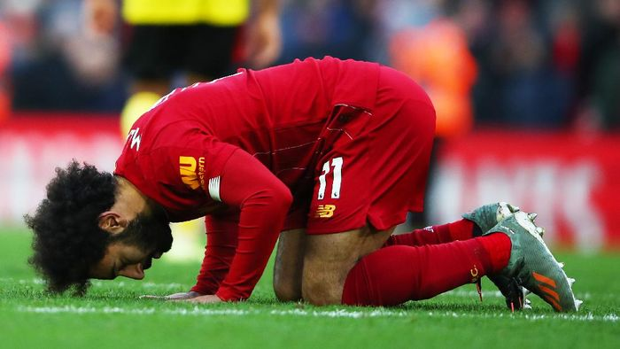 LIVERPOOL, ENGLAND - DECEMBER 14: Mohamed Salah of Liverpool celebrates after scoring his teams second goal during the Premier League match between Liverpool FC and Watford FC at Anfield on December 14, 2019 in Liverpool, United Kingdom. (Photo by Clive Brunskill/Getty Images)