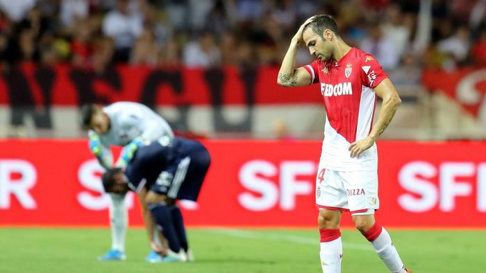 Monacos Spanish midfielder Cesc Fabregas reacts during the French L1 football match between AS Monaco (ASM) and Olympique Lyonnais (OL) at the Stade Louis II stadium in Monaco on August 9, 2019. (Photo by VALERY HACHE / AFP)