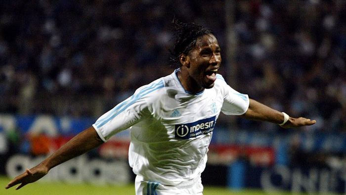 Marseilles Ivorian forward Didier Drogba jubilates after scoring the second goal during the UEFA Cup semi-final second leg football match against Newcastle, 06 May 2004 at the Velodrome stadium in Marseille.  AFP PHOTO GERARD JULIEN (Photo by GERARD JULIEN / AFP)