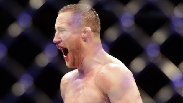 Justin Gaethje celebrates after winning his match against Tony Ferguson in a UFC 249 mixed martial arts bout, early Sunday, May 10, 2020, in Jacksonville, Fla. (AP Photo/John Raoux)