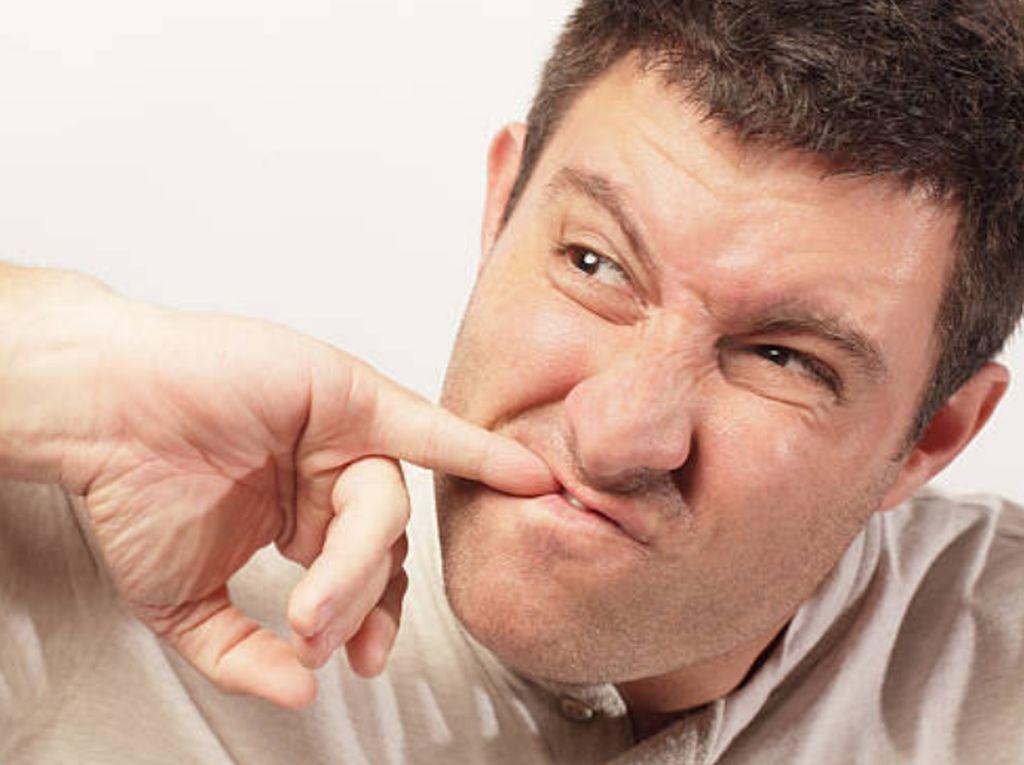 Tak Sengaja Menelan Sisa Makanan yang Terselip di Gigi, Batalkah Puasa?