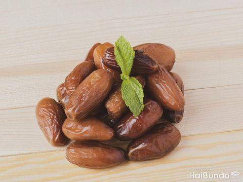 juicy Dried date fruits or kurma, ramadan meal with mint leaf, flat lay