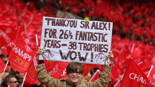 MANCHESTER, ENGLAND - MAY 12: A Manchester United fan shows off a banner to honour Manager Sir Alex Ferguson prior to the Barclays Premier League match between Manchester United and Swansea City at Old Trafford on May 12, 2013 in Manchester, England. (Photo by Alex Livesey/Getty Images)