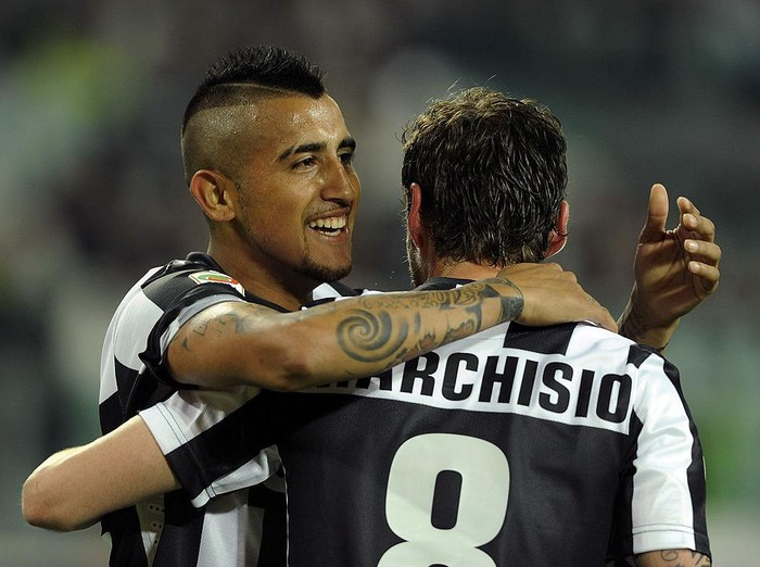 TURIN, ITALY - APRIL 21:  Arturo Vidal (L) of Juventus celebrates with team-mate Claudio Marchisio after scoring their teams first goal from a penalty during the Serie A match Juventus FC v AC Milan at Juventus Arena on April 21, 2013 in Turin, Italy.  (Photo by Claudio Villa/Getty Images)
