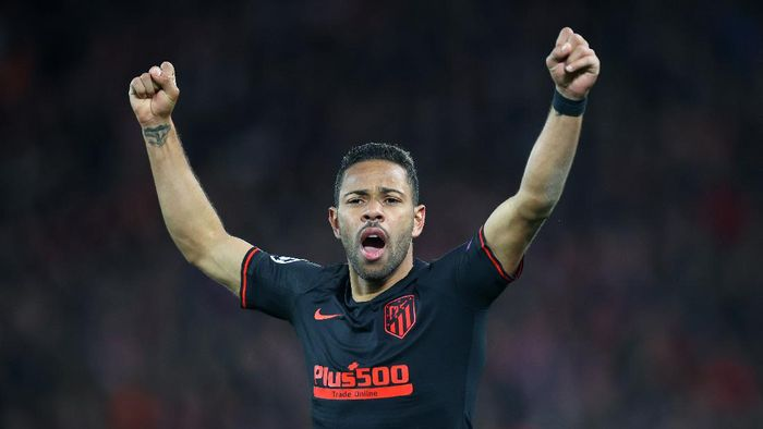 LIVERPOOL, ENGLAND - MARCH 11: Renan Lodi of Atletico Madrid celebrates his sides second goal during the UEFA Champions League round of 16 second leg match between Liverpool FC and Atletico Madrid at Anfield on March 11, 2020 in Liverpool, United Kingdom.  (Photo by Julian Finney/Getty Images)