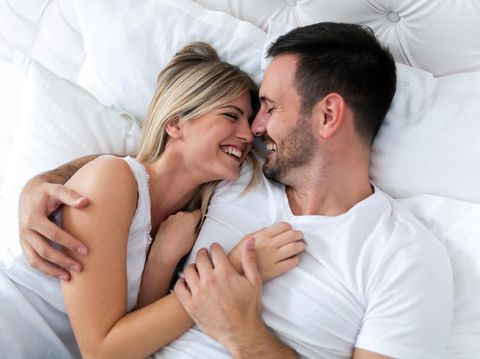 Happy young couple having romantic times in bedroom
