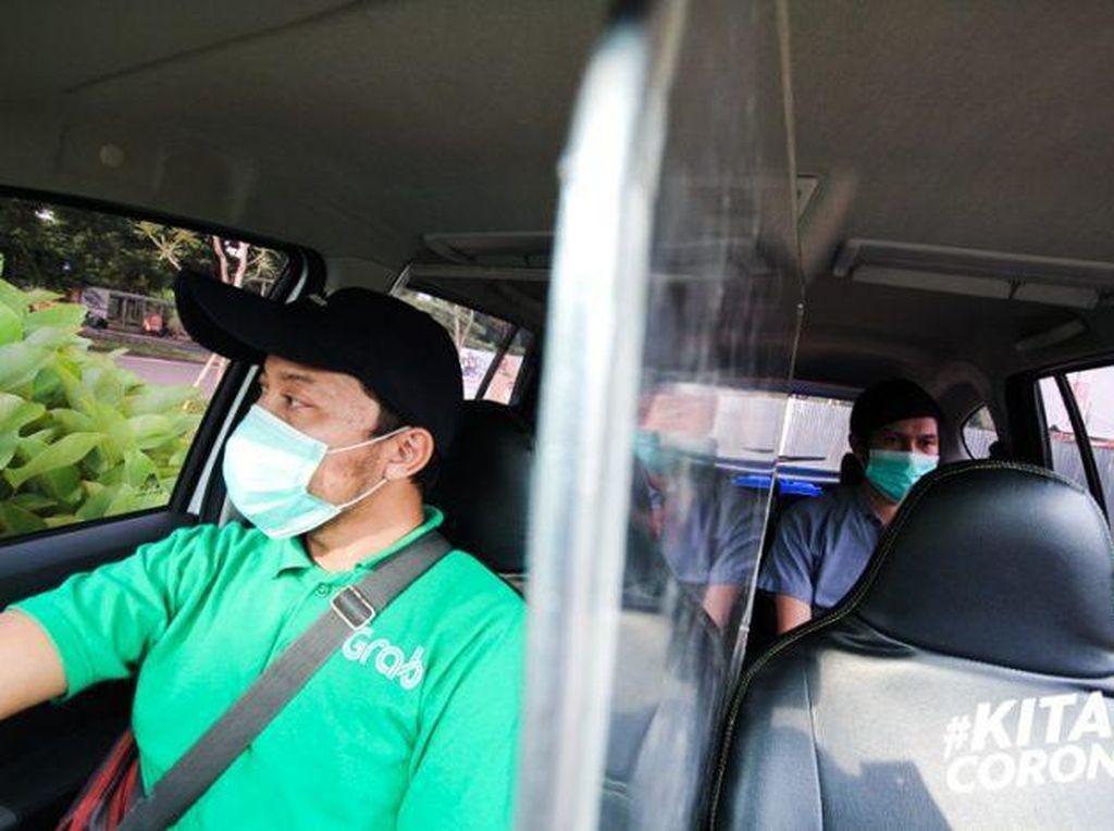 Kerja di Tengah Pandemi, Para Pekerja Ini Terbantu GrabCar Protect