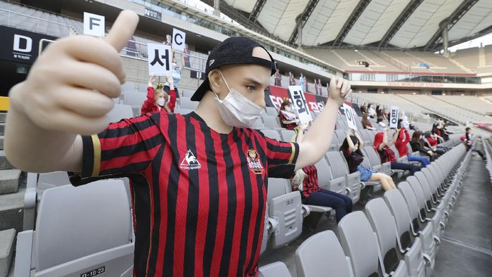 In this May 17, 2020 photo, cheering mannequins are installed at the empty spectators seats before the start of a soccer match between FC Seoul and Gwangju FC at the Seoul World Cup Stadium in Seoul, South Korea. A South Korean professional soccer club has apologized after being accused of putting sex dolls in empty stands during a match Sunday in Seoul. In a statement, FC Seoul expressed