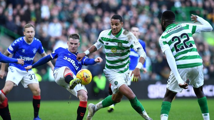 GLASGOW, SCOTLAND - DECEMBER 29:  Steven Davis of Rangers and Christopher Jullien of Celtic challenge for the ball during the Ladbrokes Premiership match between Celtic and Rangers at Celtic Park on December 29, 2019 in Glasgow, Scotland.(Photo by Mark Runnacles/Getty Images)