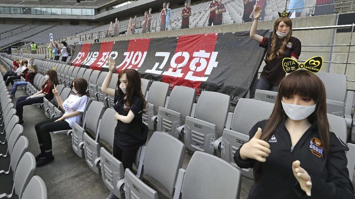 In this May 17, 2020, photo, cheering mannequins are installed at the empty spectators seats before the start of a soccer match between FC Seoul and Gwangju FC at the Seoul World Cup Stadium in Seoul, South Korea. A South Korean professional soccer club has apologized after being accused of putting sex dolls in empty stands during a match Sunday in Seoul. In a statement, FC Seoul expressed